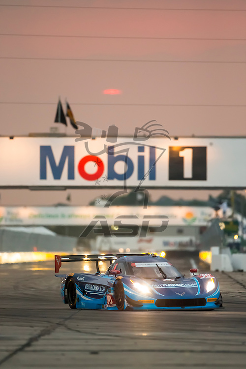 Sebring, FL - Mar 19, 2015:  The Spirit of Daytona Corvette DP Prototype races through the turns at 12 Hours of Sebring at Sebring Raceway in Sebring, FL.