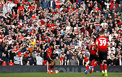 A general view of Manchester United fans in the stands as they watch the match action during the Premier League match at Old Trafford, Manchester.