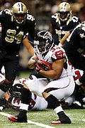 NEW ORLEANS, LA - NOVEMBER 11:  Michael Turner #33 of the Atlanta Falcons runs the ball against the New Orleans Saints at Mercedes-Benz Superdome on November 11, 2012 in New Orleans, Louisiana.  The Saints defeated the Falcons 31-27.  (Photo by Wesley Hitt/Getty Images) *** Local Caption *** Michael Turner