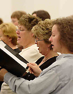 (left to right) Dee Earl, Jane Rike and Lynette Atkinson are three of the women of the Dayton Philharmonic Chorus rehearsing for their upcoming performance of Mahler's Third Symphony, Tuesday, January 2, 2007.