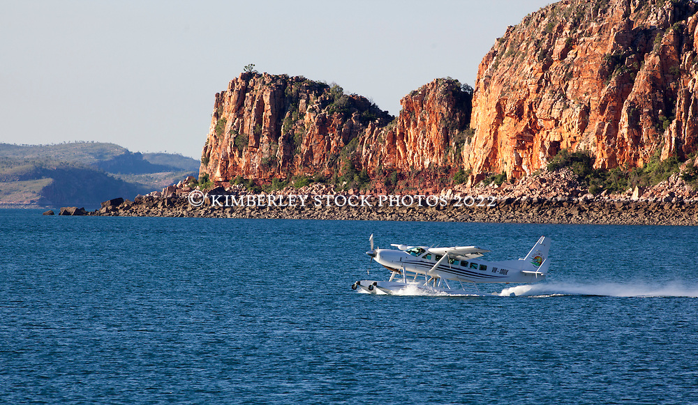 A Horizontal Falls Seaplane Adventures' seaplane takes off near Naturalist Island at the mouth of the Hunter River.