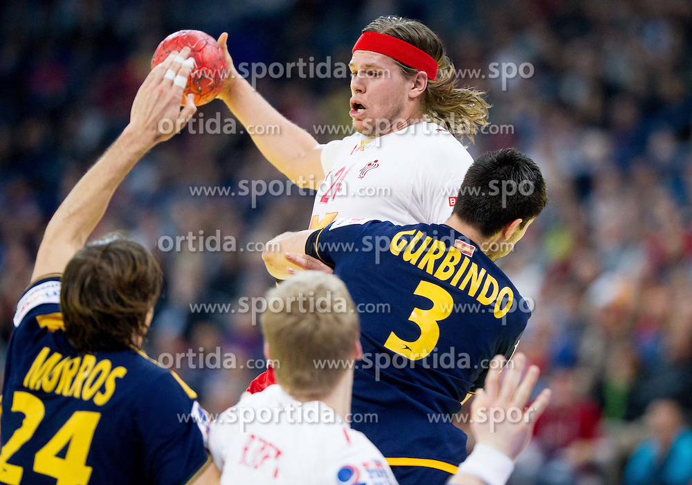 Mikkel Hansen of Denmark vs Eduardo Gurbindo of Spain during handball match between Denmark and Spain in 1st Semifinal at 10th EHF European Handball Championship Serbia 2012, on January 27, 2012 in Beogradska Arena, Belgrade, Serbia. Denmark defeated Spain 25-24. (Photo By Vid Ponikvar / Sportida.com)