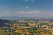 The Tuscan countryside seen from the hill of Cortona. On the left you can see Lake Trasimeno.