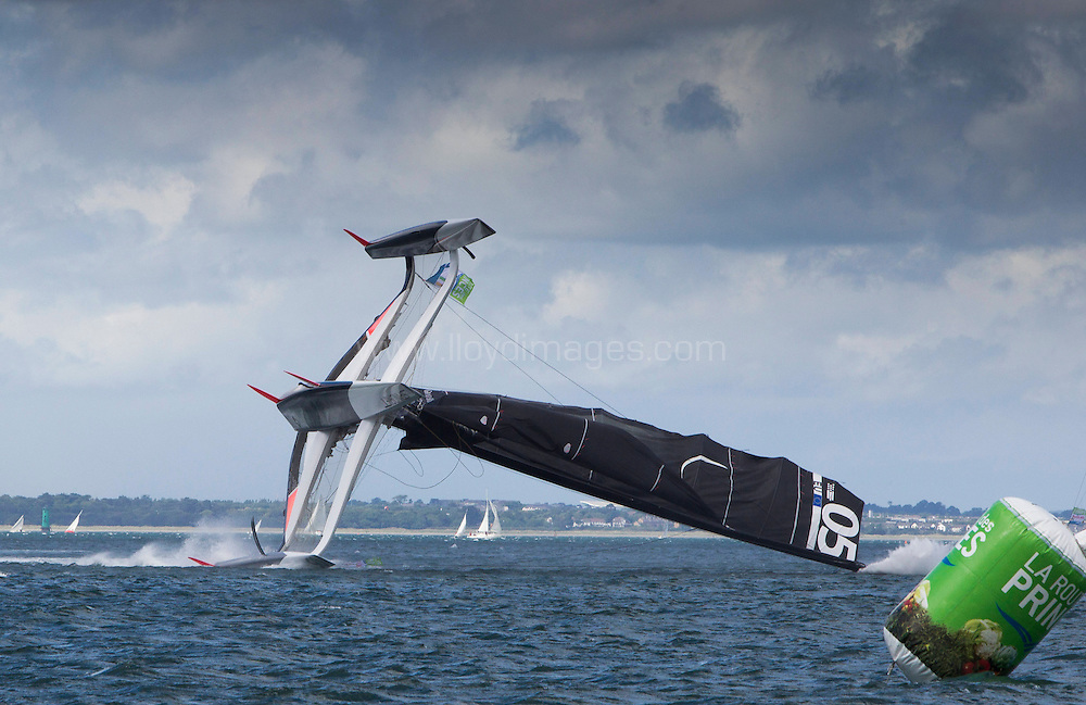 La Route des Princess. Dun Laoghaire - Dublin.<br /> Pictures of the of the Spindrift MOD70 capsizing during todays In-Port Race<br /> Credit: Lloyd Images