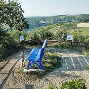 """Panchina Gigante blu a Lo Sbaranzo<br /> <br /> Nelle Langhe le panchine giganti si stanno moltiplicando, nate da un'idea del designer americano Chris Bangle. Sulle colline patrimonio dell'Unesco le """"Big Bench"""" sono diventate un'attrazione turistica<br /> <br /> Langhe giant benches are multiplying, On the UNESCO heritage hills """"Big Bench"""" have become a tourist attraction.."""
