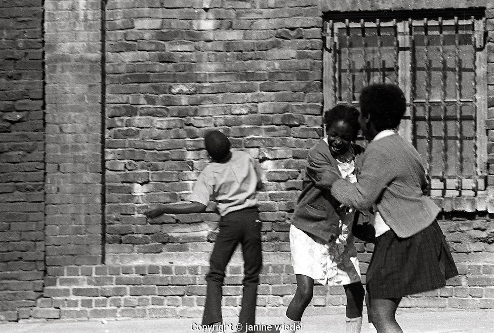 Young children playing in the street of San Franciso 1960's