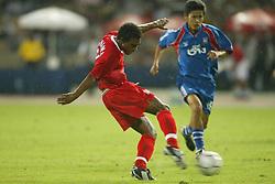 BANGKOK, THAILAND - Thailand. Thursday, July 24, 2003: Liverpool's Florent Sinama-Pongolle fires in a shot against Thailand during a preseason friendly match at the Rajamangala National Stadium. (Pic by David Rawcliffe/Propaganda)