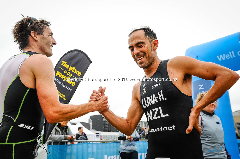 Two competitors congratulate each other at the finish line of the Sovereign Tri Series, Waterfront, Wellington, New Zealand. Saturday 14 March 2015. Copyright Photo: Mark Tantrum/www.Photosport.co.nz