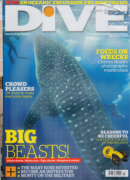 Dive Magazine, March 2011. Whale shark vertical in the water, with scuba divers, off of Darwin, Galapagos. Eric Cheng magazine covers.