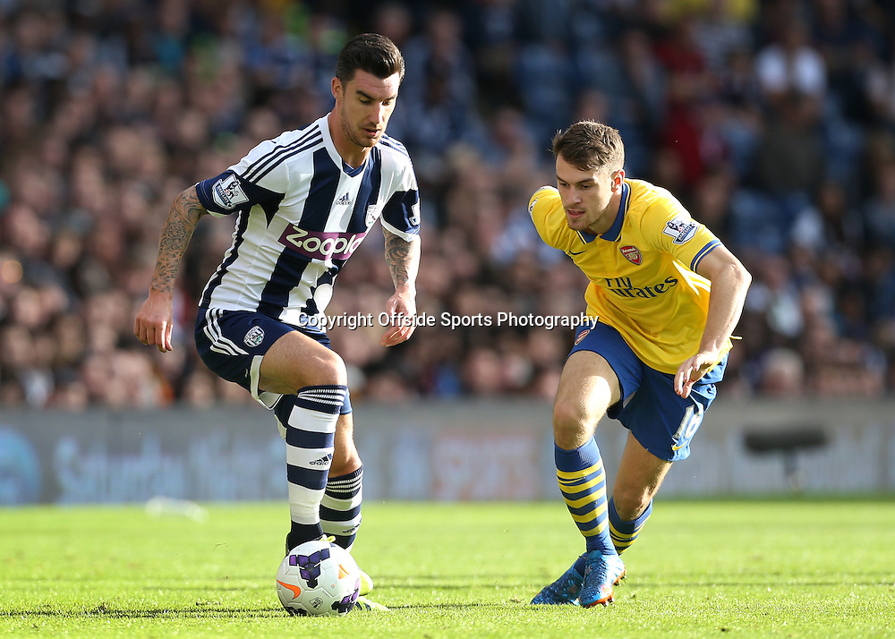 6th October 2013 - Barclays Premier League - West Bromwich Albion v Arsenal - Liam Ridgewell of West Brom battles with Aaron Ramsey of Arsenal - Photo: Simon Stacpoole / Offside.