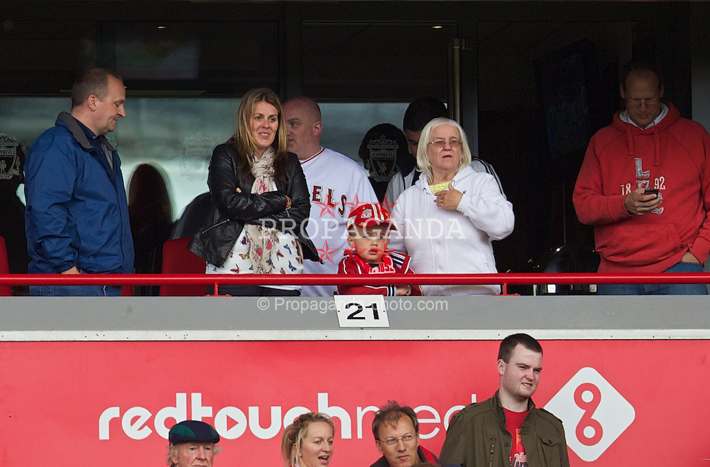 LIVERPOOL, ENGLAND - Sunday, August 17, 2014: Liverpool supporter seven-year-old Josh Humphrey watches his team play from the Red Touch Media executive box during the Premier League match against Southampton at Anfield. (Pic by David Rawcliffe/Propaganda)