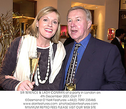 SIR TERENCE & LADY CONRAN at a party in London on 4th December 2001.			OUY 77