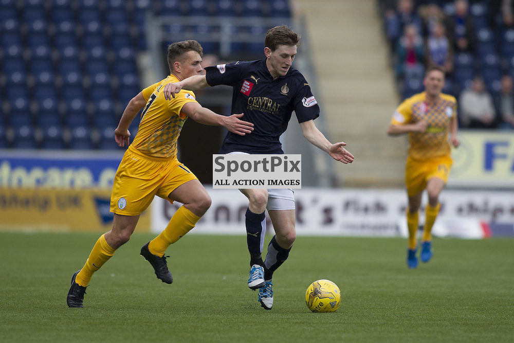 Blair Alston of Falkirk takes the ball past Mark Russell of Morton during the Ladbrokes Scottish Championship match between Falkirk FC and Greenock Morton FC at Falkirk Stadium on October 17, 2015 in Falkirk, Scotland. Photo by Jonathan Faulds/SportPix