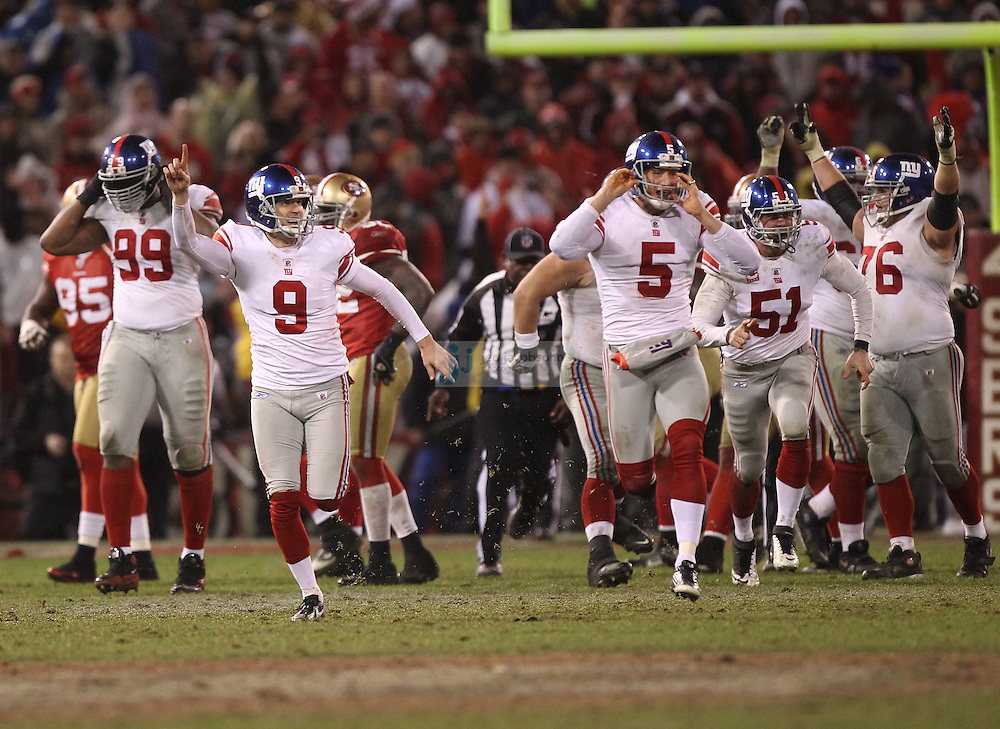 Lawrence Tynes #9 of the New York Giants celebrates after kicking the  game winning field goal in overtime against the San Francisco 49ers during the NFC championship game at Candlestick Park in San Francisco, California, USA 22 Jan 2012..The Giants defeated the 49ers 20-17. The Giants defeated the 49ers 20-17. (Photo by Jed Jacobsohn)