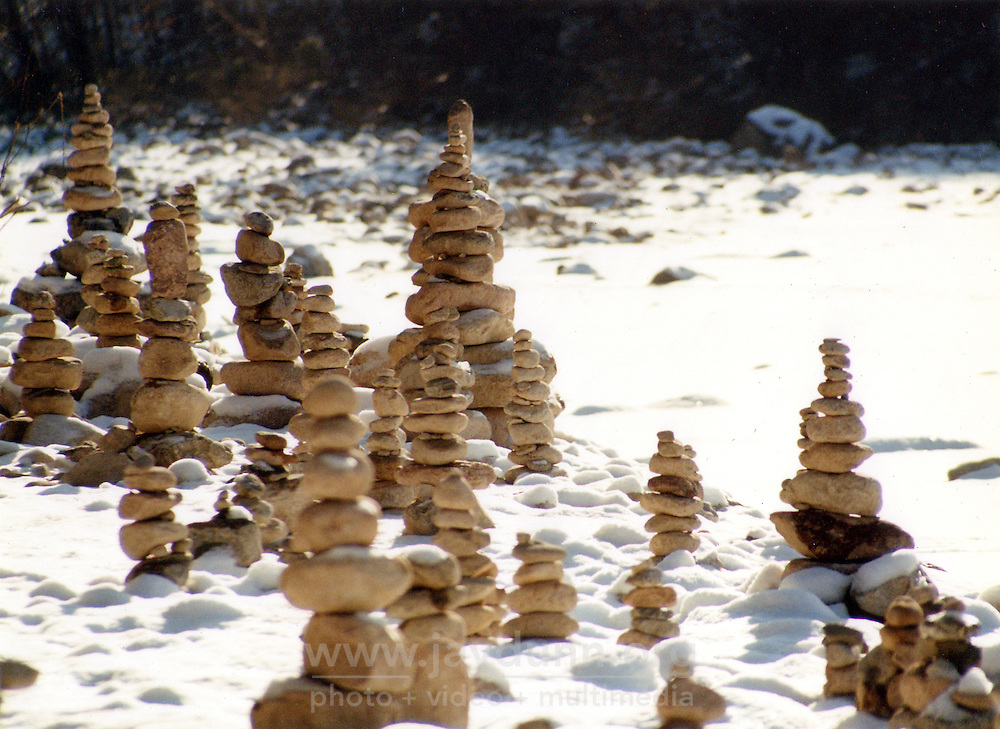 "South Korea, Sokcho, 2001. ""Doltap,"" or Buddhist prayers made with stones, beside a frozen riverbank deep in South Korea's forested eastern seacoast."