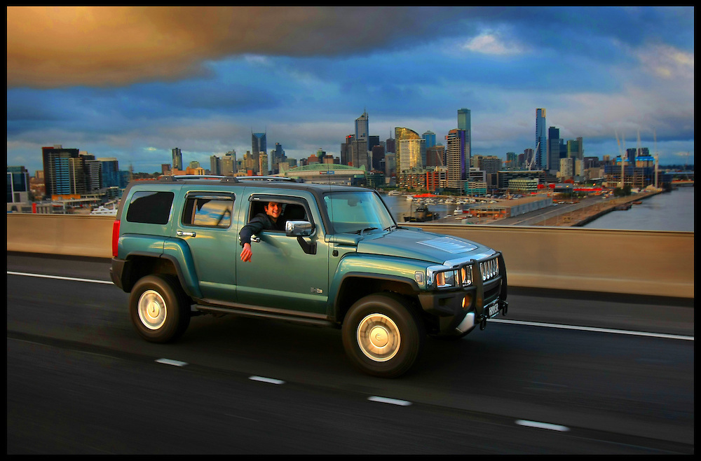 Peter Tripatgis on the Bolte Bridge in his Hummer which he says he will drive no matter what the price of petrol  Pic By Craig Sillitoe  14/06/2008 SPECIALX 000 melbourne photographers, commercial photographers, industrial photographers, corporate photographer, architectural photographers, This photograph can be used for non commercial uses with attribution. Credit: Craig Sillitoe Photography / http://www.csillitoe.com<br />