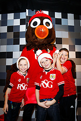 Bristol City mascot Scrumpy poses with young fans as Season ticket holders and members of Bristol Sport 7s and Forever Bristol take part in a Bristol Sport Christmas Party - Mandatory byline: Rogan Thomson/JMP - 22/12/2015 - SPORT - Ashton Gate Stadium - Bristol, England - Bristol Sport Christmas at Ashton Gate.