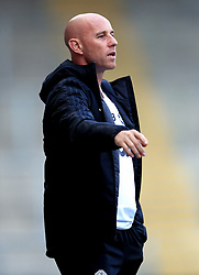 Manchester United Coach Nicky Butt gestures on the touchline