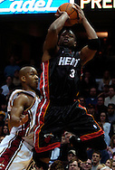 PHOTO BY DAVID RICHARD.Dwayne Wade, right, of Miami puts up a shot against the defense of Eric Snow of Cleveland April 1, 2006.