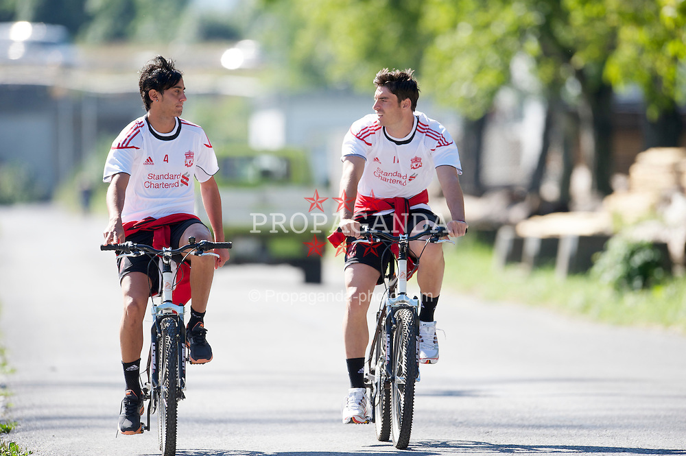 BAD RAGAZ, SWITZERLAND - Monday, July 19th, 2010: Liverpool's Alberto Aquilani (L) and Albert Riera (R) arrive for a training session on a bicycle during the Reds' preseason training camp in Switzerland. (Pic by David Rawcliffe/Propaganda)