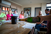 A tour guide pours English Balfour Brute sparkling wine for tasting to a group of visitors at Hush Heath Winery, Staplehurst, Kent, England, UK.  (photo by Andrew Aitchison / In pictures via Getty Images)