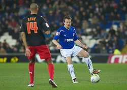CARDIFF, WALES - Tuesday, February 1, 2011: Cardiff City's Lee Naylor in action against Reading's Jimmy Kebe during the Football League Championship match at the Cardiff City Stadium. (Photo by Gareth Davies/Propaganda)