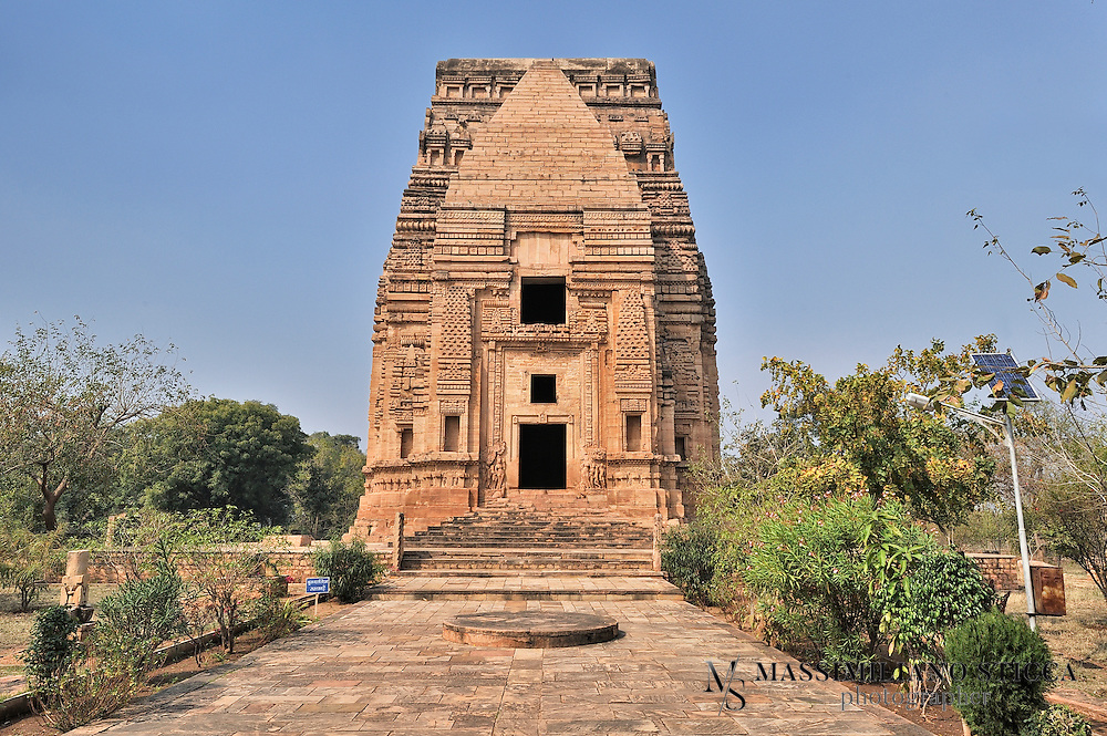 The Telika Mandir, or 'oil-man's temple', owes its name to Teli, a term for an oil grinder or oil dealer. Many suggestions have been put forward to explain this name historically, but in fact the name is not old, the temple being used for processing oil before the British occupied the fort and used the building, albeit temporarily, as a coffee shop. The Telika Mandir is the loftiest temple among all the buildings in Gwalior Fort with a height of about 30m. The temple consists of a garba griha, that is, sanctum proper for the deity, and an antarala to enter into the temple. It can be approached by a flight of steps provided on the eastern side. The most striking feature of the temple is the wagon-vaulted roof, a form used over rectangular shrines which normally accommodated a row of Mother Goddesses. The goddesses from the interior vanished centuries ago and have not been traced, even in fragments. The exterior walls of the temple are richly decorated with sculptures, many of which are damaged; the niches, shaped like temples, are empty. The building carries a dedicatory inscription to the goddess in a niche on the southern side, but otherwise does not have any history. The architectural style, discussed by a number of architectural historians, points to a date in the late 8th Century. The building was erected just as the Gurjara Pratiharas were asserting their power over central India. The entrance gateway on the eastern side is a later addition of the British period, made by Major Keith in 1881. It was built as a way of saving various historic pillars and other pieces no longer in their original context