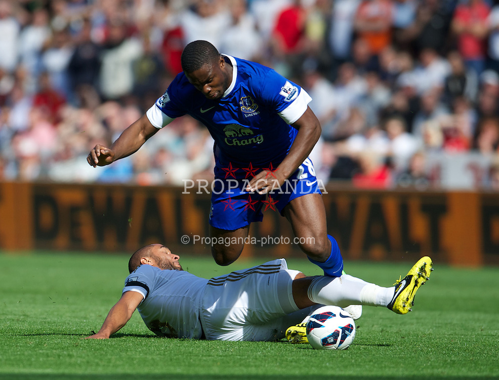 SWANSEA, WALES - Saturday, September 22, 2012: Everton's Victor Anichebe is brought down by Swansea City's Ashley Williams during the Premiership match at the Liberty Stadium. (Pic by David Rawcliffe/Propaganda)
