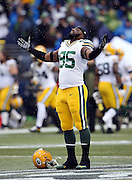 Green Bay Packers defensive end Datone Jones (95) looks skyward in the rain as he holds his arms and palms up in the air before the NFL week 20 NFC Championship football game against the Seattle Seahawks on Sunday, Jan. 18, 2015 in Seattle. The Seahawks won the game 28-22 in overtime. ©Paul Anthony Spinelli