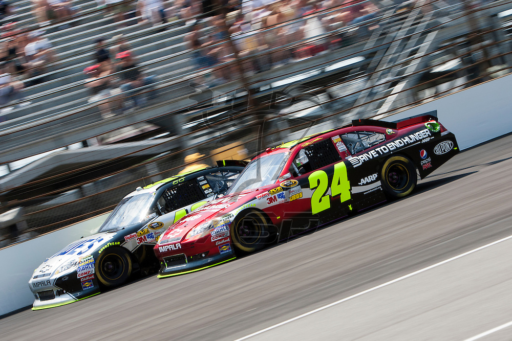 Speedway, IN  - JUL 31, 2011:  Jeff Gordon (24) and Jimmie Johnson (48) race to turn one for the Brickyard 400 presented by BigMachineRecords.com at Indianapolis Motor Speedway in Speedway, IN.