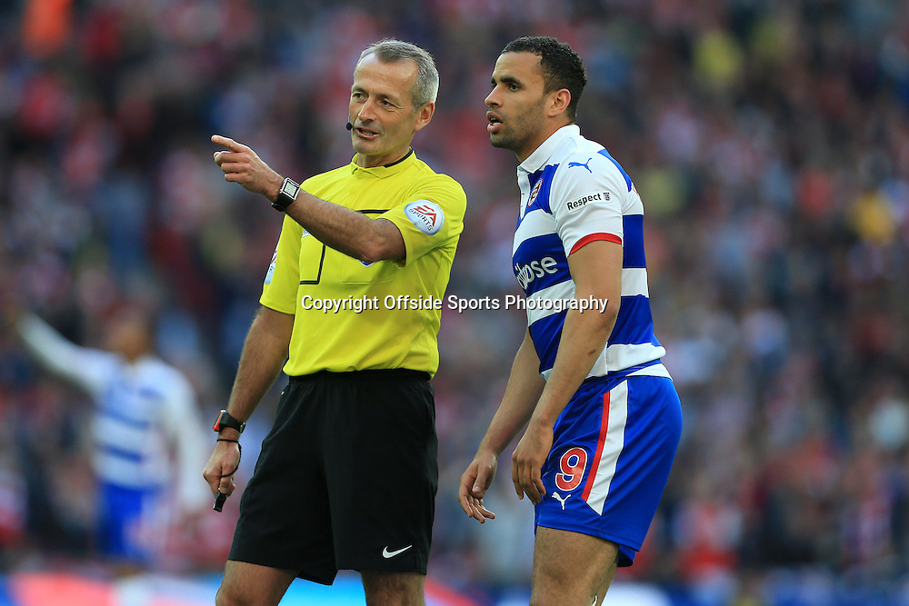 18th April 2015 - FA Cup - Semi-Final - Reading v Arsenal - Referee Martin Atkinson chats to Hal Robson-Kanu of Reading - Photo: Simon Stacpoole / Offside.