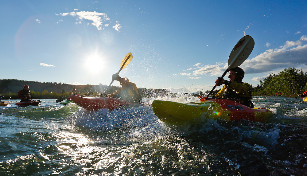 Yukon Canoe and Kayak Club members battle the current at the intake during their Tuesday evening paddle on the Yukon River in Whitehorse.