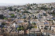 Aerial landscape of old Arab Albaicin quarter and surrounding barrios of Moorish city of Granada.