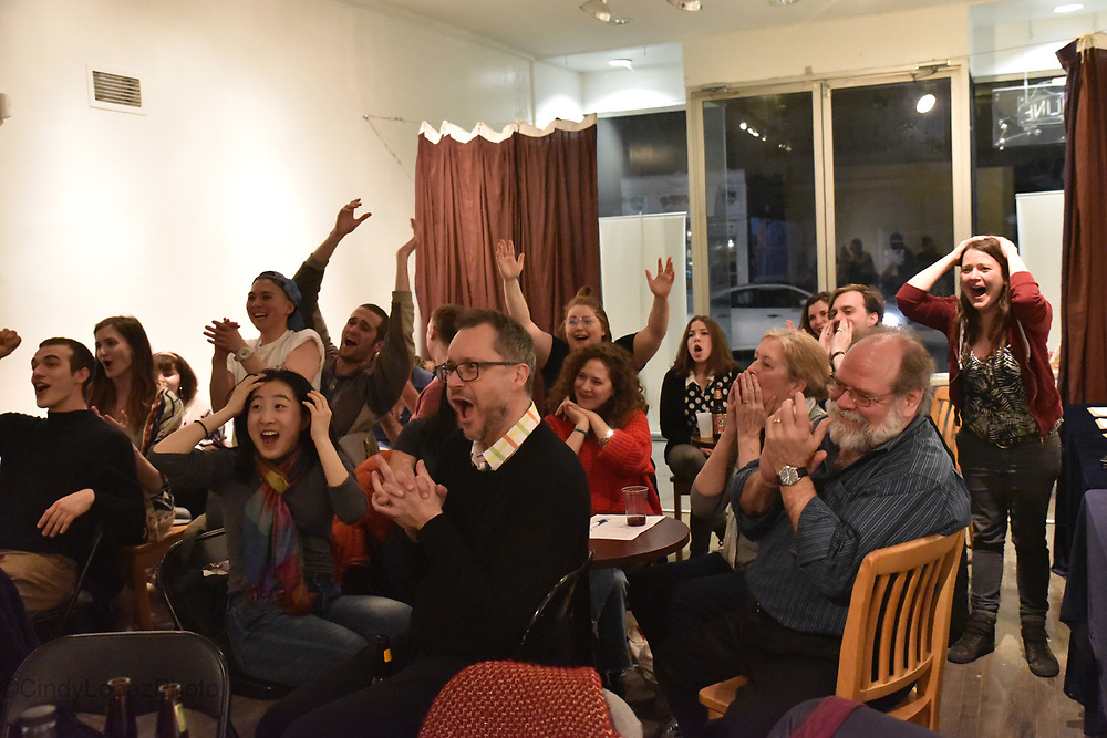 Teams from Montreal's English theatre community cheer on in the final rounds of the Quebec Drama Federation Quiz Night fundraiser at MainLine Gallery. (Published in Quebec Drama Federation, March 2018).