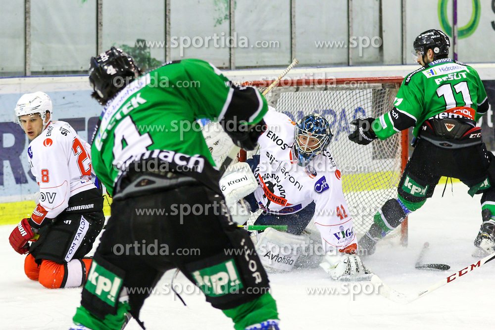 Igor Cvetek of Olimpija vs Aleksis Ahlqvist of Jesenice during ice hockey game between HDD Telemach Olimpija and SIJ Acroni Jesenice in 1st leg of Finals of Slovenian National Championship 2015, on April 9, 2015 in Hala Tivoli, Ljubljana, Slovenia. Photo by Matic Klansek Velej / Sportida