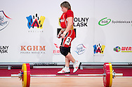 Marina Sisoeva from Uzbekistan lifts in Clean and Jerk competition women's 53 kg Group B during weightlifting IWF World Championships Wroclaw 2013 at Centennial Hall in Wroclaw on October 21, 2013.<br /> <br /> Poland, Wroclaw, October 21, 2013<br /> <br /> Picture also available in RAW (NEF) or TIFF format on special request.<br /> <br /> For editorial use only. Any commercial or promotional use requires permission.<br /> <br /> Mandatory credit:<br /> Photo by © Adam Nurkiewicz / Mediasport
