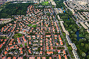Nederland, Zuid-Holland, Den Haag, 15-07-2012; Kijkduin, Vogelwijk. Beginnend rechtsonder en diagonaal naar boven, de Sportlaan. Aan weerszijden van de Sportlaan de 'Atlantikwall strook'. In dit gebied is tijdens de Tweede Wereldoorlog de bevolking geëvacueerd en de bebouwing ontruimd en/of gesloopt ivm aanleg tankgracht. Wederopbouw flats rechts van de laan..On both sides of the Sportlaan the Atlantic Wall strip. During the Second World War, the population of this area was evacuated and some of the buildings were demolished in order to build a antitank ditch...QQQ.luchtfoto (toeslag), aerial photo (additional fee required).foto/photo Siebe Swart
