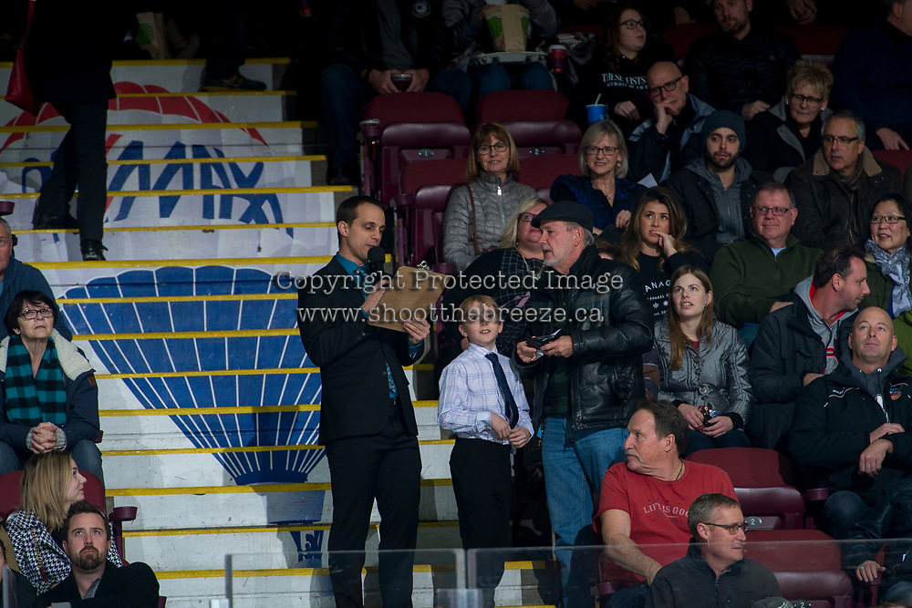 KELOWNA, CANADA - JANUARY 3: Kelowna Rockets' game host Ryan Watters stands with fans during a time out against the Tri-City Americans on January 3, 2017 at Prospera Place in Kelowna, British Columbia, Canada.  (Photo by Marissa Baecker/Shoot the Breeze)  *** Local Caption ***
