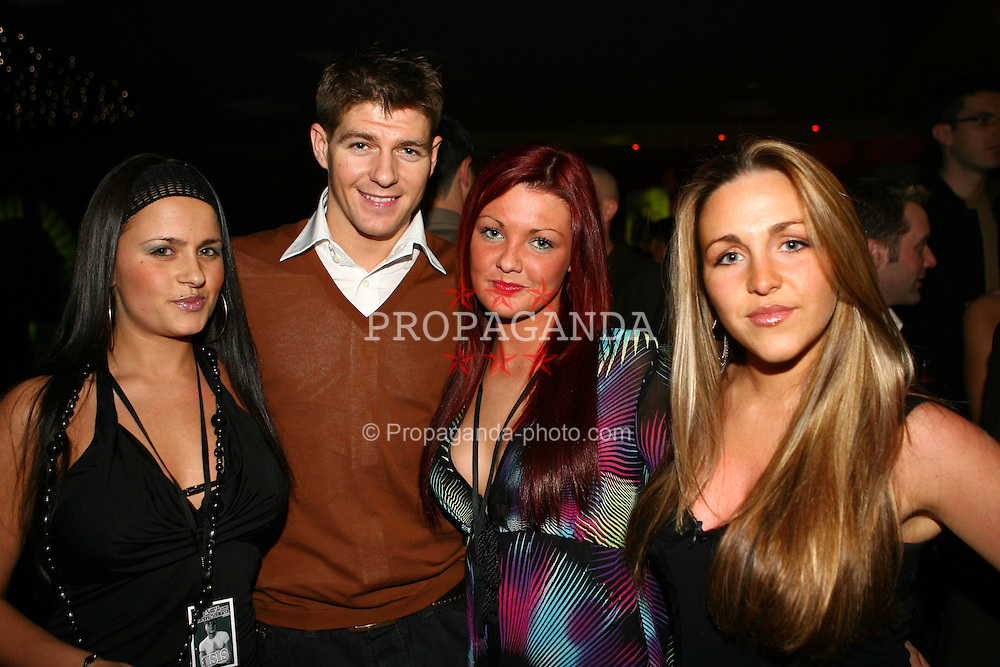 LIVERPOOL, ENGLAND - SATURDAY, MARCH 25th, 2006: Liverpool and England midfielder Steven Gerrard with the girl band Candy Club at the UK launch of Djibril Cisse's clothing label Klubb 9 at the Isis Club, Liverpool. (PIc by David Rawcliffe/Propaganda)