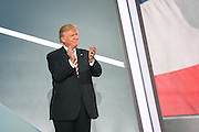 GOP Presidential nominee Donald Trump applauds his running mate Gov. Mike Pence after Pence formally accepted the nomination during the third day of the Republican National Convention July 20, 2016 in Cleveland, Ohio.