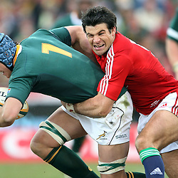 Juan Smith of South Africa tackled by Mike Phillips of the British and Irish Lions during the British and Irish Lions tour 2009