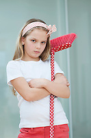 Portrait of an angry girl with broom