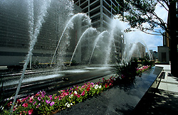 Stock photo of the fountains along the Houston Metro Light Rail tracks in downtown