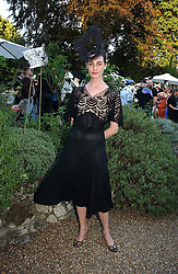 Model ERIN O'CONNOR at a party to celebrate Stephen Jones's 25 Years of Millinery held at Debenham House, 8 Addison Road, London W14 on 13th July 2006.<br />