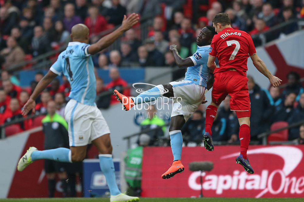 Liverpool midfielder James Milner (7)  battles with Manchester City defender Bacary Sagna (3)  during the Capital One Cup match between Liverpool and Manchester City at Anfield, Liverpool, England on 28 February 2016. Photo by Simon Davies.
