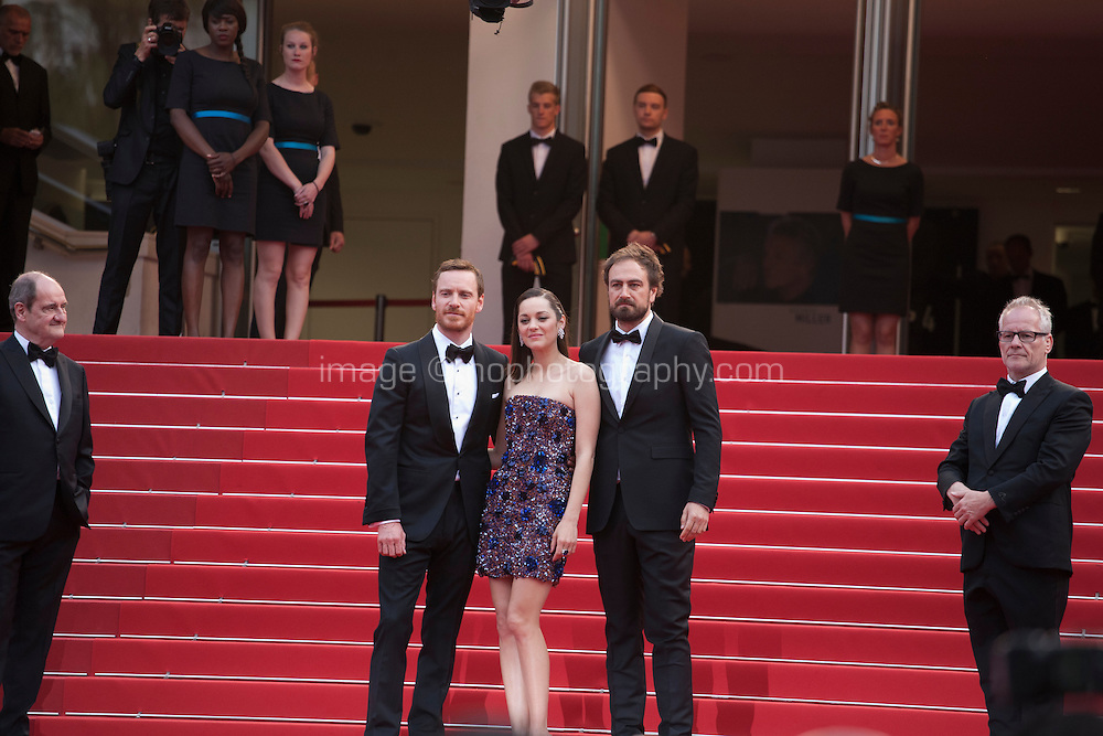 Actor Michael Fassbender, actress Marion Cotillard,  and director Justin Kurzel on the red steps  at the gala screening for the film Macbeth at the 68th Cannes Film Festival, Saturday 23rd May 2015, Cannes, France.