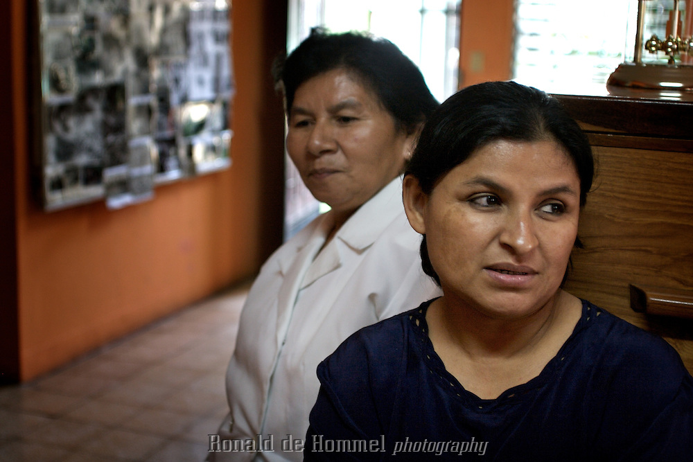 14-11-06, San Salvador, El Salvador, Comadres, an organisation of women that lost relatives in the war kept a record of all missing people. Every morning they would go into the streets to photograph all the victims of the deathsquads for identification. They still have books with tousands of tortured corpses, proof of the cruelty of the regime..The women of Comadres still fight for justice for the survivors. ..November 2006, San Salvador, El Salvador. Twenty years ago El Salvador was ravaged by a bloody civil war that lasted more than twelve years. The FMLN, The National Liberation Front Farabundo Marti, fought from the jungle in the countryside against the dictatorial regime that was supported by the United States. .Twenty years later El Salvador is still one of the most dangerous countries in the Americas. Every day 11 violent deaths are registered. How many are not, is unclear. Now the violence is mostly between rivalling streetgangs. But the money and the weapons still come from the USA. This time not from political support but through remittances of Salvadoren?os that legally or illegally live in the States. .