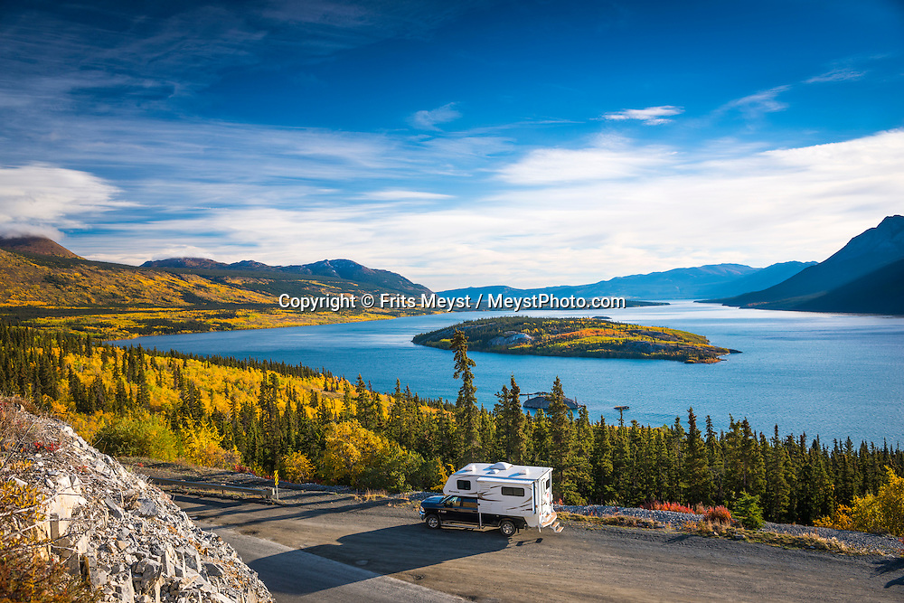 Carcross, Yukon Territory, Canada, September 2014. A camper on the scenic Klondike Highway, overlooking Tagish Lake and Bove Island. With scenic drives in abundance, the Yukon Territory is a driver's dream. The territory boasts a network of well-maintained highways leading through an exhilarating combination of postcard scenery, historic communities, cultural attractions and adventure outings.The Yukon Territory received world fame during the Klondike Gold Rush in 1898.  Photo by Frits Meyst / MeystPhoto.com