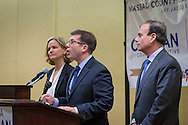 Uniondale, New York, USA. January 30, 2017. At left, Nassau County Legislator LAURA CURRAN (D-Baldwin), 48, candidate for Nassau County Executive, receives endorsement from Democratic Party leaders. A primary is expected. JACK SCHNIRMAN, speaking, received endorsement for County Comptroller. At right, JAY S. JACOBS, N. C. Democratic Committee Chairman, made the announcements backing the candidates. Curran is in her second term as Nassau County Legislator for 5th Legislative District.