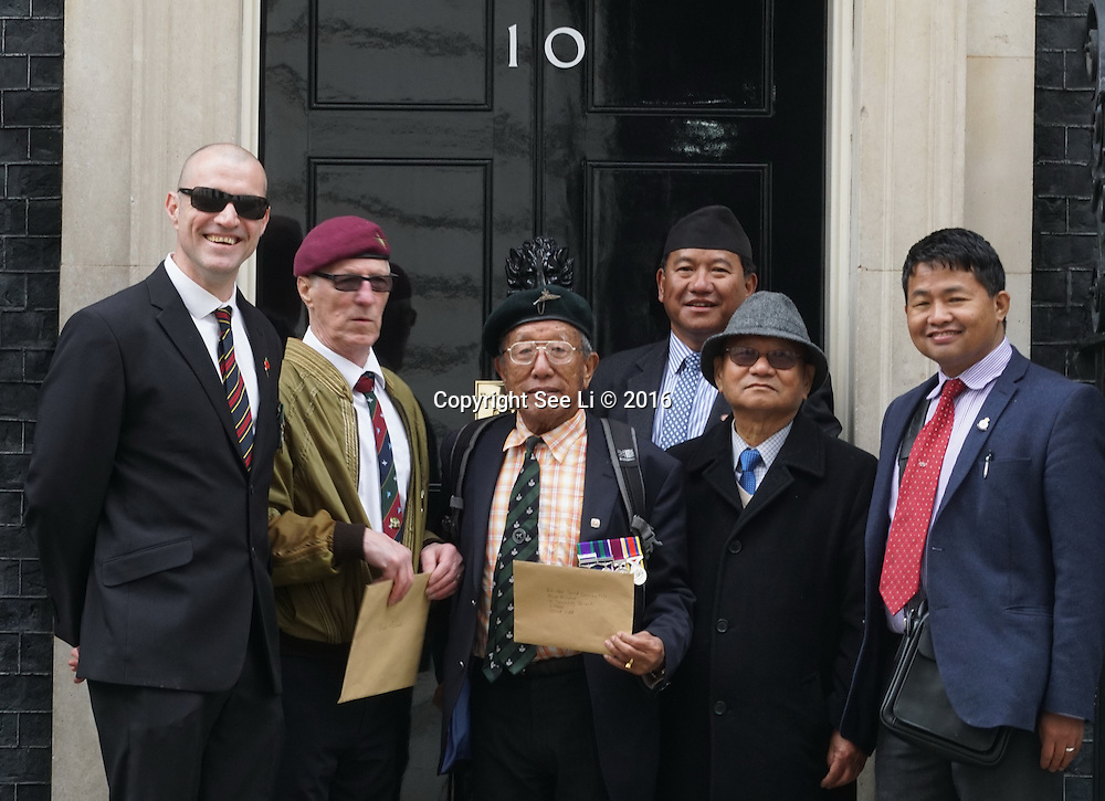 London,England,UK : Gurkha veterans ,Chris Taylor and Nigal Kelsall is a founder of UK Veterans - One Voice hang a partition to 10 Downing Street, London. Photo by See Li